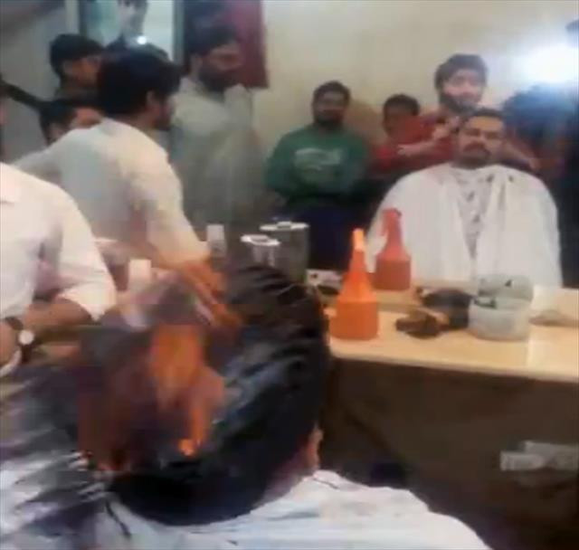 Çılgın berber müşterisinin saçını yaktı